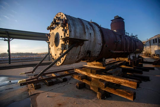 The Denver and Rio Grande Western Railroad locomotive No. 223 is seen outside Union Station in Ogden, Utah on Tuesday, Dec. 10, 2019. The 138-year-old historic train sits in pieces, consigned to limbo after a local restoration effort was frozen out. (Ben Dorger/Standard-Examiner via AP)