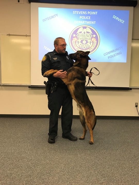 Stevens Point Police Officer J.D. Ballew stands with his new partner, Barry the police dog. The department purchased Barry after the unexpected death of Luna in September, one of two police dogs the department owns.