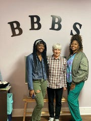 From left to right, Shari Mathis, mentor Cheryl Naylor and mother Omesha Clark. They're the longest enrolled family at BBBS.