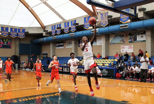 Leon junior Anthony Crowe goes up for a fastbreak layup as Leon beat Plant City 55-50 during a Capital City Holiday Classic game at TCC's Eagledome on Dec. 20, 2019.
