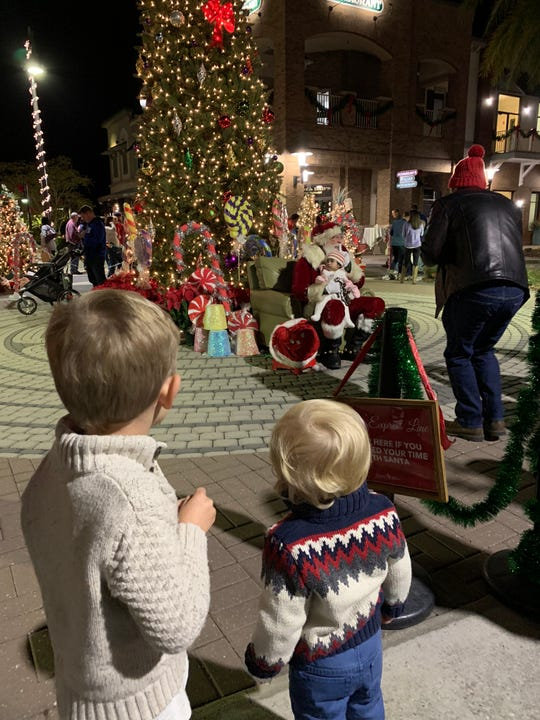 Children eagerly await their visit with Santa at the Tree Jubilee.