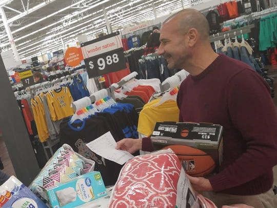 Superintendent Rocky Hanna and colleagues shop for local families in need after receiving a $50,000 donation from the Ballard Law Firm to the Foundation for Leon County Schools.