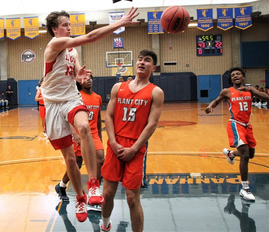 Leon senior Mitchell Guse makes a pass as Leon beat Plant City 55-50 during a Capital City Holiday Classic game at TCC's Eagledome on Dec. 20, 2019.