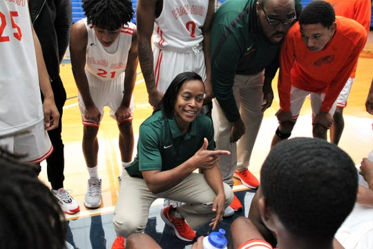 Second-year FAMU DRS boys basketball coach Dione Smith talks to her team during a timeout as FAMU DRS fell 63-61 to Marianna during a Capital City Holiday Classic game at TCC's Eagledome on Dec. 20, 2019.