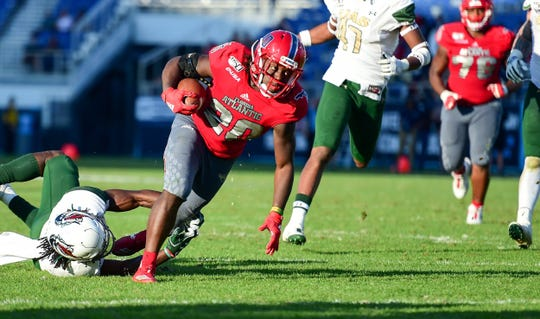 Florida Atlantic running back Malcolm Davidson looks to pick up extra yardage against UAB in the Conference USA championship game on Dec. 7, 2019, in Boca Raton.