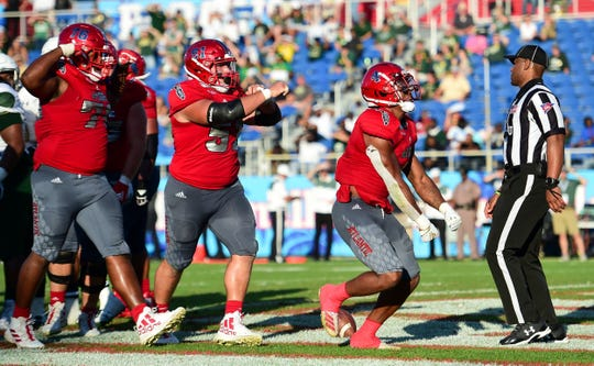 Florida Atlantic running back BJ Emmons celebrates a touchdown over UAB in the Conference USA championship game on Dec. 7 in Boca Raton.