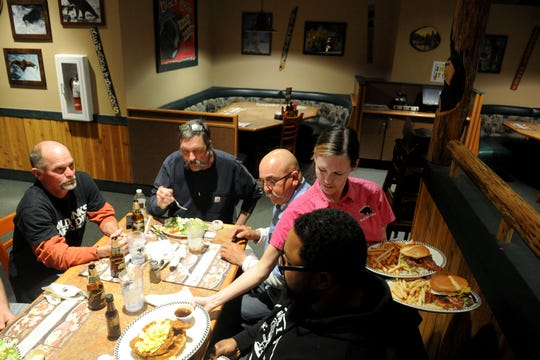 Roland Lutz, from left, Rocky Hawkins, Louie Flores, Blair Redmond get served by Nicole Smith at Black Bear Diner in Simi Valley. Breakfast and lunch are served all day at the bear-themed restaurant.