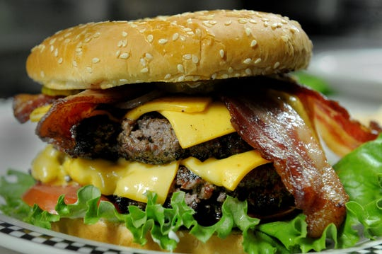 Bob's double burger is ready to eat at Black Bear Diner in Simi Valley.