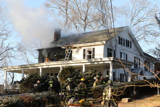 Firefighters battle a fire at a group home at 1035 Broadway in Thornwood, Friday, Dec. 20, 2019.