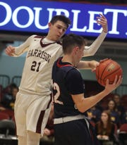 Harrison's Sam Ptashnik (21) tries to steal the ball from Eastchester's John Russell (12) during Slam Dunk Tournament at Westchester County Center in White Plains Dec. 20, 2019. Harrison defeats Eastchester 56-53.