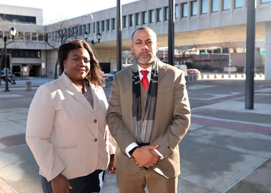 Attorney Christina T. Hall is pictured with her client Tyquan Brown, who was allegedly body slammed by a Mount Vernon police officer last month while handcuffed and shackled, are pictured in front of the Westchester County Courthouse in White Plains, Dec. 20, 2019.