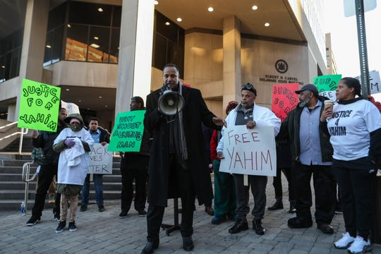 Terence Jones speaks in support of Yahim Harris, an unarmed man who was shot by Wilmington Police earlier this year, at a protest on Friday, Dec. 20.