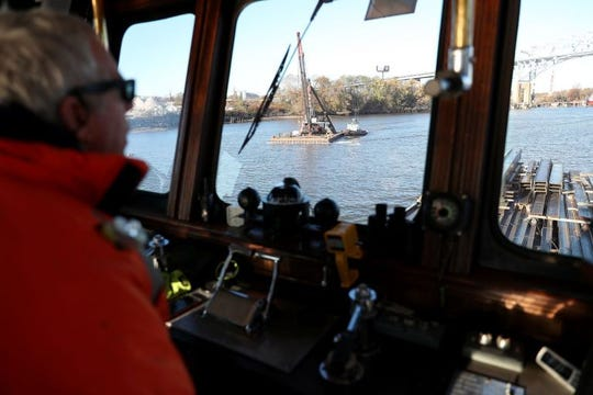 Capt. Jesse Briggs, who works for River Services, guides a tugboat on the Schuylkill.