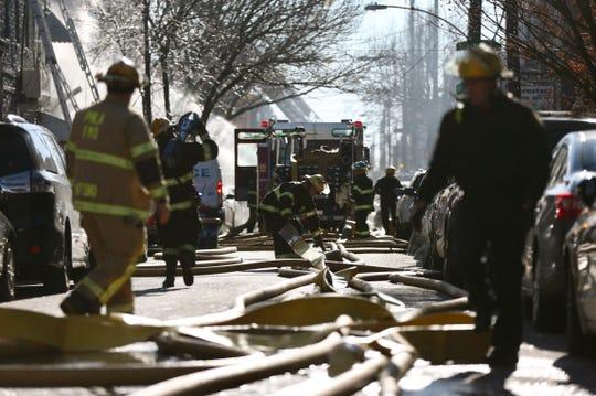 Philadelphia firefighters battle a fire in Philadelphia on Thursday, Dec. 19, 2019. (Tim Tai/The Philadelphia Inquirer via AP)