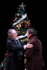 """Mary Martello stars as Scrooge and Sarah Gliko in many roles, including Bob Cratchit, in the Delaware Theatre Company's all-woman  production of """"A Christmas Carol,"""" which ends Dec. 29."""