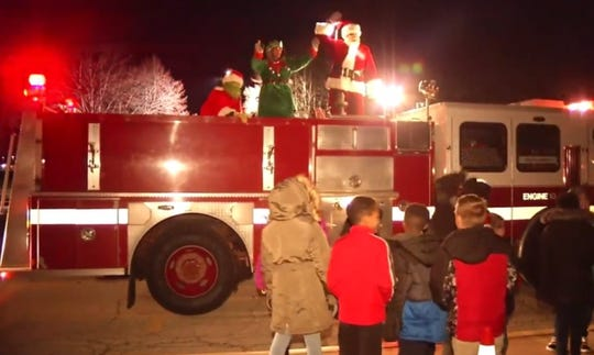 Middletown residents meet with Santa, an elf and the Grinch Wednesday night.