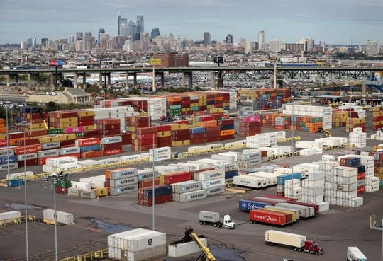 Stacks of cargo containers sit at the port awaiting transport from the Packer Avenue Marine Terminal.