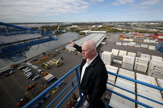 Leo A. Holt, president of Holt Logistics talks about the port from atop one of the Super post-Panamax Cranes at the Packer Avenue Marine Terminal.