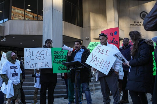 Branden Fletcher speaks in support of Yahim Harris, an unarmed man who was shot by Wilmington Police earlier this year, at a protest on Friday, Dec. 20.