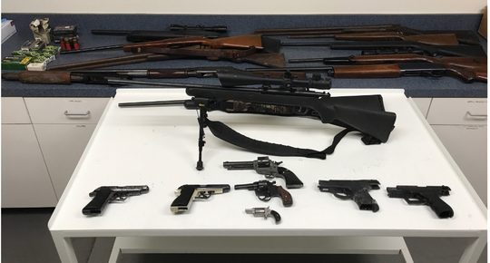 Delaware State Police arrested seven people, recovered 19 guns and confiscated several dozen dozen bags of heroin as part of a monthslong drug investigation that ended Thursday.