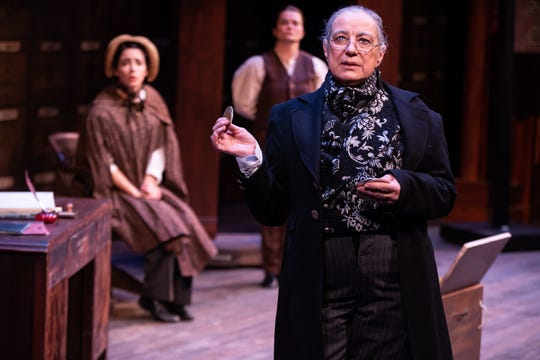 """Mary Martello, right, stars as Scrooge with Michaela Shuchman in many roles and Sarah Gliko in many roles, including  Bob Cratchit, at the Delaware Theatre Company's all-woman  production of """"A Christmas Carol,"""" which ends Dec. 29."""