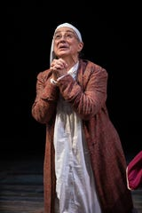 """Mary Martello stars as Scrooge in the Delaware Theatre Company's all-woman  production of """"A Christmas Carol,"""" which ends Dec. 29."""