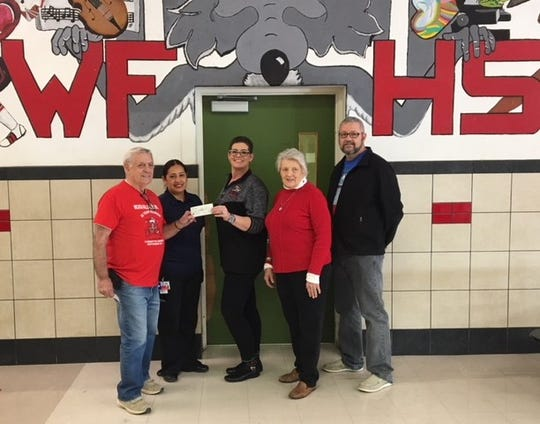 Old High alumni hand off a check to pay off students' lunch debts. Pictured from left to right are class of 1962 Doug Lincoln, Wichita Falls High School cafeteria manager Patti Uribez, WFHS Principal Christy Nash, alumna Mary Lynn Owens Boyd and WFHS Assistant Principal Wayne Calhoun.