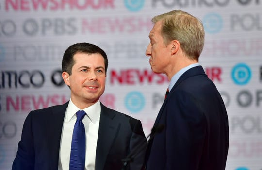 Democratic presidential hopeful Mayor of South Bend, Indiana, Pete Buttigieg (L) speaks to billionaire and philanthropist Tom Steyer (R) during a break in the sixth Democratic primary debate of the 2020 presidential campaign.