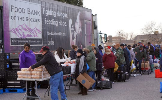 Clients of the Food Bank of the Rockies line up to collect food distribution in Denver on Dec. 19, 2019. The Trump administration is changing food stamp requirements in a move that poverty experts say will increase demand on food banks nationwide.