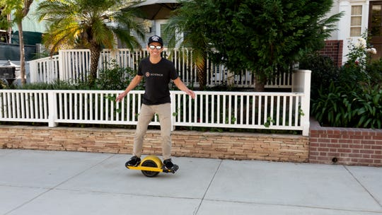 Tech investor Peter Pham riding a Manhattan Beach walk street on the One Wheel Pint, a $950 electric one wheel scooter of sorts, that can go as fast as 16 miles per hour.
