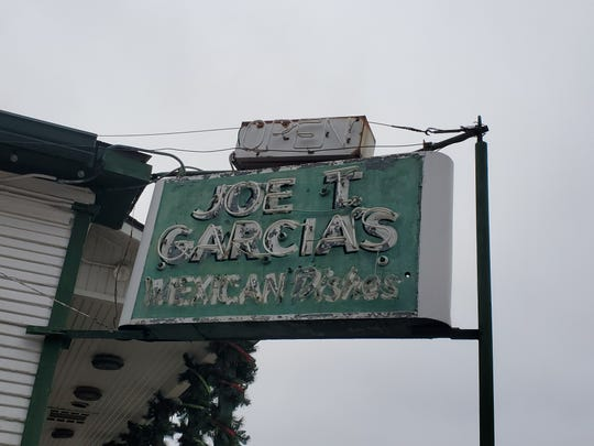 """If Joe T. Garcia's had a motto it might be """"If it ain't broke don't fix it,"""" and many fixtures, like this ancient neon sign, resist modern upgrades."""