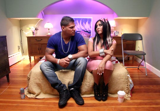 """Ronnie Ortiz-Magro and Nicole """"Snooki"""" Polizzi wait for their next interview in the """"smoosh room"""" at the """"Jersey Shore"""" house in Seaside Heights in 2011."""