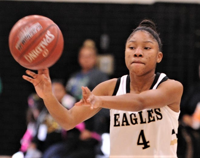 Abilene High's Zikyria Shaw passes the ball to a teammate during the Lady Eagles' game against San Angelo Lake View. AHS won 62-30 on Friday, Dec. 20, 2019, at Eagle Gym.