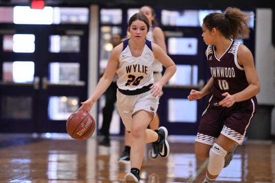 Wylie's Grace Steadman (20) brings the ball down the court against Brownwood's Hadley Monroe (10) at Bulldog Gym on Friday, Dec. 20, 2019. The Lady Bulldogs didn't allow a point in the third quarter in a 46-34 comeback win.