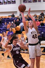 Wylie's Bailey Roberts (42) takes a shot after being fouled against Brownwood at Bulldog Gym on Friday, Dec. 20, 2019. The Lady Bulldogs didn't allow a point in the third quarter in a 46-34 comeback win.