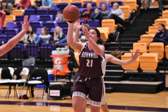 Brownwood's Natalie Edmonds (21) takes a shot against Wylie at Bulldog Gym on Friday, Dec. 20, 2019. The Lady Lions let a 13-point halftime lead slip away in a 46-34 loss.