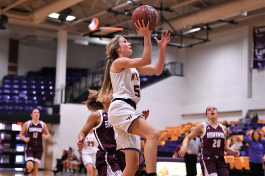 Wylie's Morgan Travis (5) goes up for a layup after a steal against Brownwood at Bulldog Gym on Friday, Dec. 20, 2019. The Lady Bulldogs didn't allow a point in the third quarter in a 46-34 comeback win.