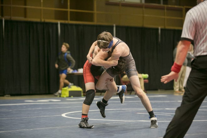 Enka's Caleb Boone faced off against Pisgah's Gabriel Carr during the Great Smoky Mountain Grapple at the U.S. Cellular Center on December 20, 2019.  The tournament featured 31 boys Varsity teams from across the region and a first-time Girls Invitational Division. -Colby Rabon (colbyrabon@gmail.com)
