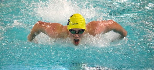 Bainbridge's Ben Cohen competes in the 100-yard butterfly in the Spartans' home meet against Lakeside on Dec. 18, 2019. Bainbridge is the defending three-time Class 3A state boys swim/dive champion.