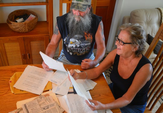Lee and Jill Phelps, pictured here in June 2018, in their South Patrick Shores home with a pile of paperwork from their research into health concerns in South Patrick Shores in the late '80s and early '90s.  Jill started the petition back then that eventually helped get the radar at Patrick Air Force Base moved away from the base.