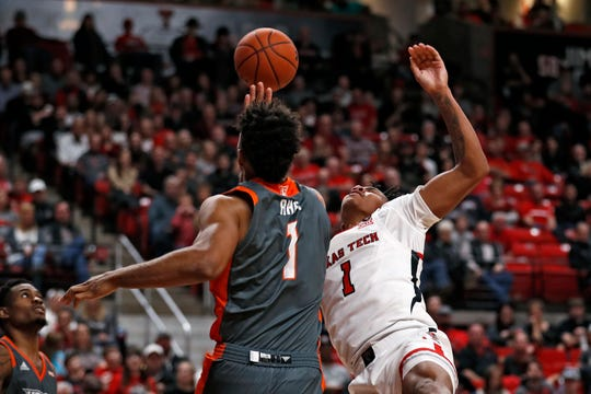 Texas-Rio Grande Valley's Sean Rhea (1) blocks the shot by Texas Tech's Terrence Shannon Jr. (1) during the second half of an NCAA college basketball game Saturday, Dec. 21, 2019, in Lubbock, Texas. (AP Photo/Brad Tollefson)