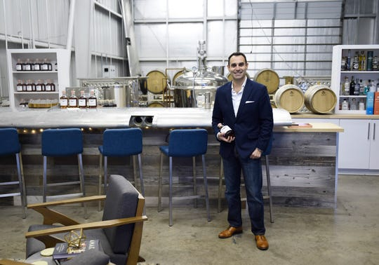 Nathan Bitz discusses Aerodrome Distilling, Thursday, Dec. 19, 2019, in Flour Bluff. The bottle labels refer to an old Navy tradition where sailors were given a daily ration of rum.