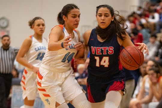 Veterans Memorial's Samantha Perez drives the ball up the court as Carroll's Clara Garcia guards her during their game at Carroll High School on Friday, Dec. 20, 3019.