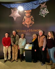 Family members of Army PFC. Francis X. McGraw of Camden gather at the Smithsonian history museum's Medal of Honor section in Washington, D.C., where he is now remembered with a display for his valor and sacrifice during World War II in 1944.