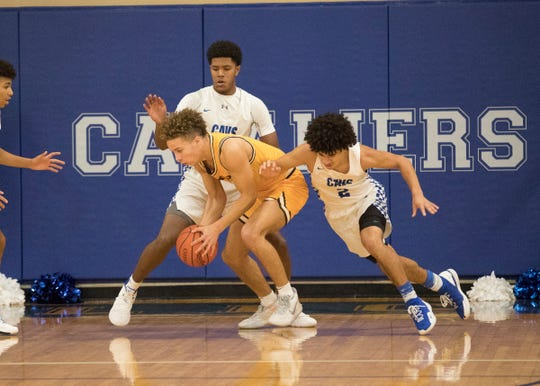 Moeller's Max Land goes against Chillicothe's Jayvon Maughmer during a 78-51 win over Chillicothe Friday night at Chillicothe High School on Dec. 20, 2019.
