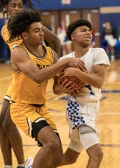 Aidan Turner of Moeller grabs hold of the ball held by his Chillicothe opponent in the 78-51 Crusader win Dec. 20, 2019.
