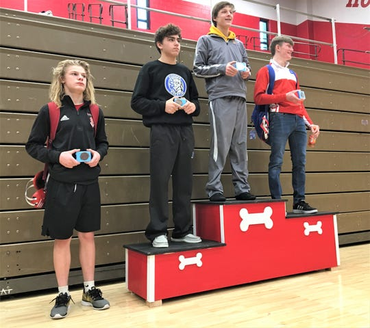 132 medalists, from left, Braidin Green (Holmes), Andrew Lewis (Simon Kenton), Micah Bowers (Campbell), Dylan Berney (Conner). Bowers was conference champion during the Northern Kentucky Athletic Conference championship wrestling meet Dec. 21, 2019 at Holmes High School, Covington KY.