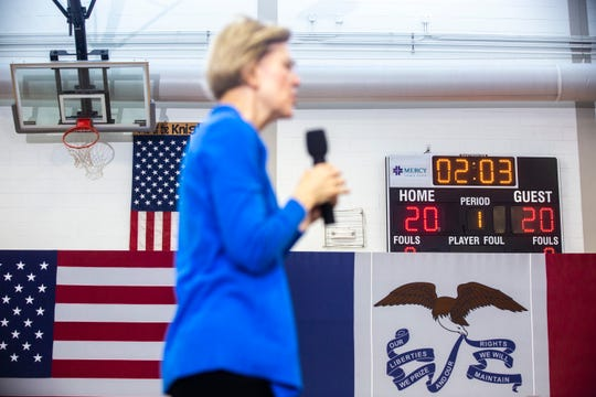 A scoreboard displays the date of the Iowa caucuses in 2020 as U.S. Sen. Elizabeth Warren, D-Mass., speaks during a town hall, Saturday, Dec. 21, 2019, at North Central Junior High School in North Liberty, Iowa.
