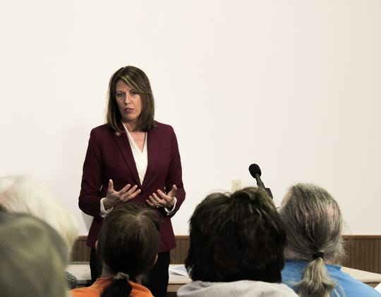 Despite receiving both boos and applause when talking about impeachment during an earlier town hall, Guthrie County people only asked questions on Iowa issues at Rep. Cindy Axne's first town hall after her impeachment vote Saturday.