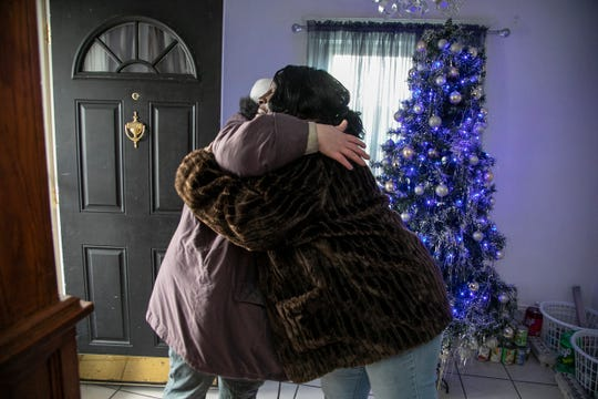 Amanda Knowlton, 32, hugs in gratitude Jackson's Mama Tu-Tu (aka Wanda Beavers) as they stand in Beaver's foyer decked out with a Christmas tree and food baskets she will be handing out to the homeless and folks in need over the holidays. Beavers feels like God put her on this earth to give back to her community. The Detroit Free Press catches up with Mama Tu-Tu Wednesday, Dec. 11, 2019.